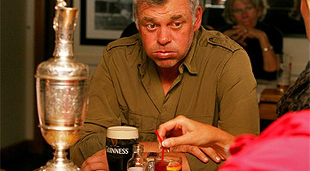 Newly crowned British Open champion Darren Clarke enjoys a pint in his local