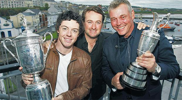 US Open champions Rory McIlroy and Graeme McDowell with Open Championship winner Darren Clarke in Portrush last night