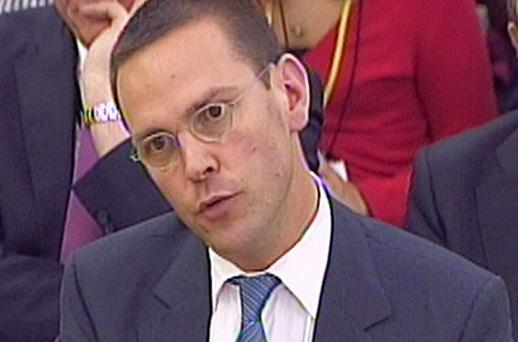 James Murdoch giving evidence to British MPs at a hearing in parliament on the phone hacking scandal on Tuesday