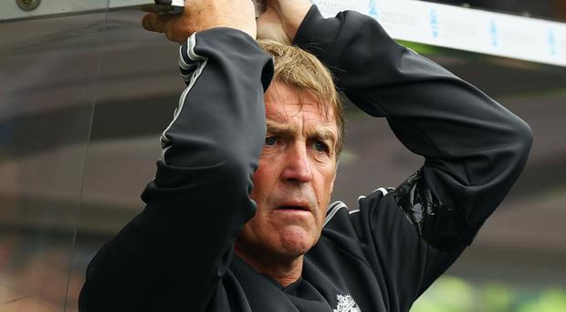 Kenny Dalglish , manager of Liverpool looks on from the bench during the Pre Season Friendly match between Hull City and Liverpool at KC Stadium