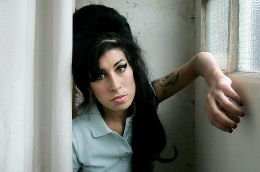 British singer Amy Winehouse poses for photographs after being interviewed by The Associated Press at a studio in north London, Friday, Feb. 16, 2007