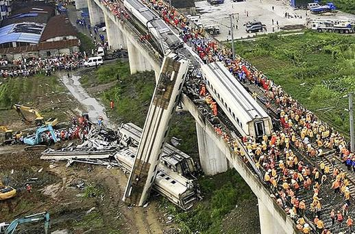 Chinese rescuers work around the wreckage of train cars in Wenzhou in east China' s Zhejiang province, Sunday, July 24, 2011. A bullet train crashed into another high- speed train, killing dozens of people and once again raising safety concerns about the country' s fast- expanding rail network. Photo: AP