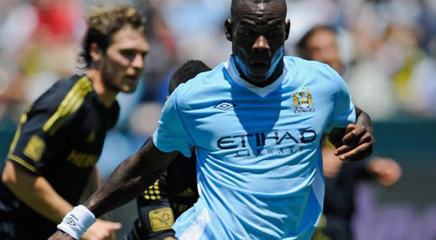 Mancini immediately took Balotelli off, before sharing a few heated words with his fellow Italian. Photo: Getty Images