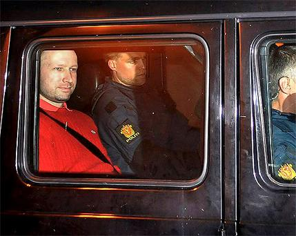 Anders Behring Breivik, left, sits in an armored police vehicle after leaving the courthouse. Photo: AP