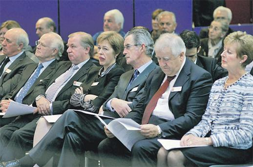Board members listen intently to the proceedings at which some investors vented their anger at the nationalisation of the bank