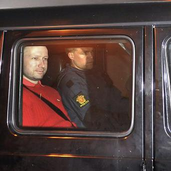 Anders Behring Breivik sits in an armoured police vehicle after leaving the Oslo courthouse (AP)