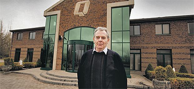 Sean Quinn poses outside his company headquarters in Ballyconnell, Co Cavan, last year