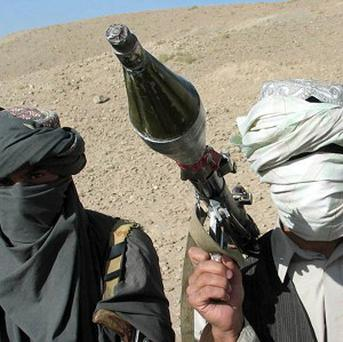 Two Afghan nationals acting as Taliban fighters in mock-exercises for the MoD have been arrested
