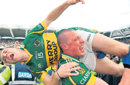 Kieran Donaghy lifts team-mate Darran O'Sullivan after Kerry won the 2009 All-Ireland final to maintain their superb record in Croke Park