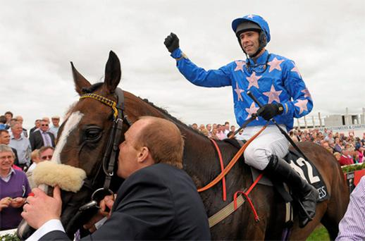 Jockey Tom Doyle celebrates aboard Moon Dice after winning the Galway Hurdle at Ballybrit yesterday