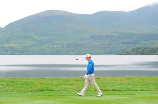 Padraig Harrington walks along the 1st fairway during the second round of the 2011 Discover Ireland Irish Open Golf Championship