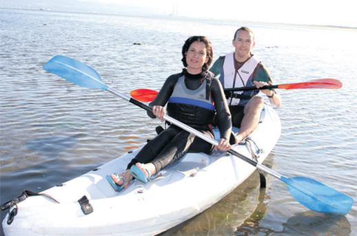 Winning team: Maebh Coyle and her husband Charles spend the day kayaking in Dalkey in order to focus on their team-building skills