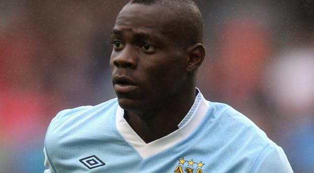 Missing home: Mario Balotelli has followed in the footsteps of Carlos Tevez by admitting he is not happy with Manchester as a city. Photo: Getty Images