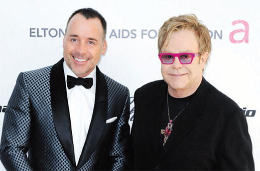 Elton John with partner David Furnish, who chairs the singer's AIDS charity