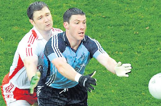 Colin Moran in action against Enda McGinley in 2008 when Tyrone's 12-point victory proved to be Paul Caffrey's final game in charge of Dublin