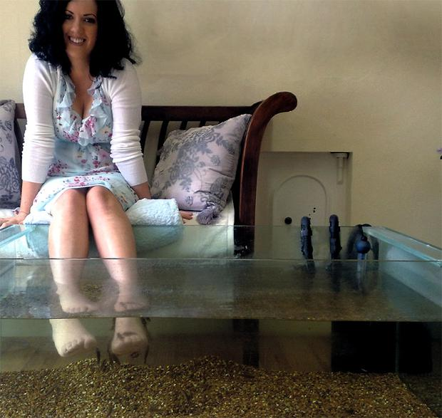 Ticklish trial: Deirdre Reynolds lets a tank of 'Doctor fish' feed on her feet, all in the name of beauty
