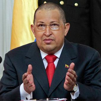 Venezuelan president Hugo Chavez has urged Muammar Gaddafi to stand firm against rebel forces in Libya (AP)