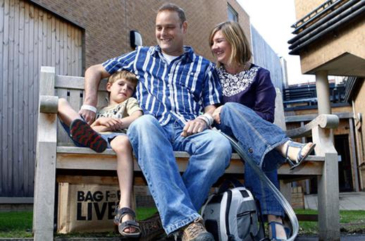 Matthew Green with his wife Gill and son Dylan, 5, in the grounds of Papworth Hospital, in Papworth, Cambridgeshire, where he became the first person in the UK to receive a total artificial heart. Photo: PA