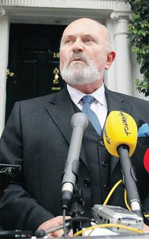 David Norris outside his house in Dublin yesterday where he announced he was quitting the race. Photo: Collins