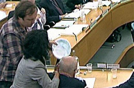 Jonathan May- Bowles ( left) holding a plate covered in foam as Rupert Murdoch ( third left) addressed the Commons Culture, Media and Sport Committee. Photo: PA
