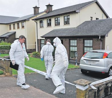 Garda forensic experts examining the scene of yesterday's fatal shooting