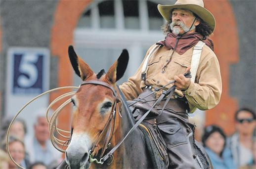 Wyoming cowboy John Fox rides his mule
