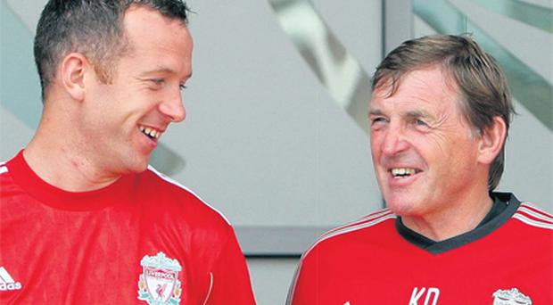 Charlie Adam shares a joke with Kenny Dalglish at Melwood yesterday