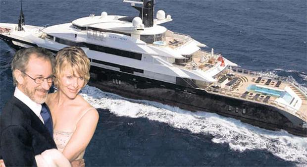 Luxury troubles: Worldfamous film director Steven Spielberg (pictured with his wife Kate Capshaw) found himself in hot water when he tried to park his yacht, the 'Seven Seas' too close to a Sardinian beach