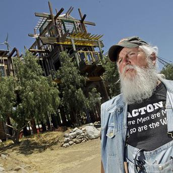 Kim Fahey with the Phonehenge West monument at his home in Acton, California (AP)