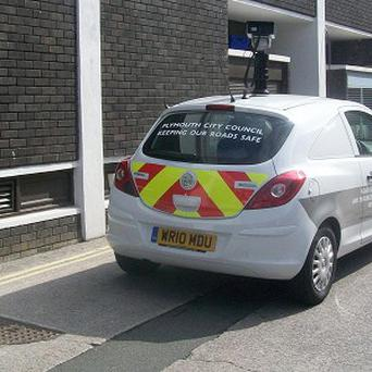 A council's camera car, which it uses to give people parking fines, was spotted parked on double yellow lines (PA/John Horton)