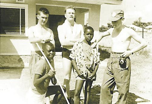 The old photograph showing Corporal Michael Nolan (left) and Trooper Pat Mullins (right) with Trooper Jerry Llewellyn (centre) and two young Congolese boys
