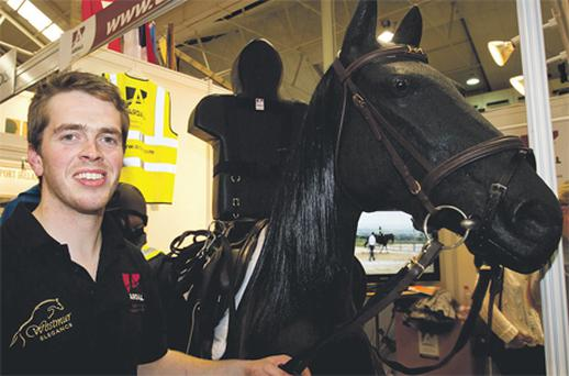 Paul Murphy, from Castlemaine, Co Kerry, with his invention 'Ardall' at the Dublin Horse Show in the RDS yesterday