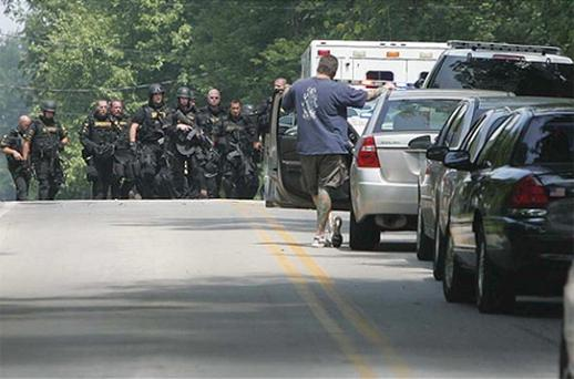 Members of the Summit County Sheriff Department leave the scene of a multiple fatal shooting in Copley Township, Ohio. Photo: AP