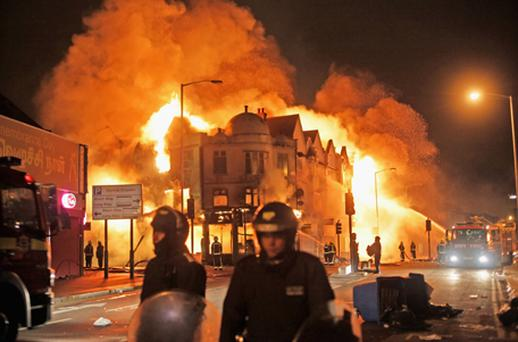 Firefighters battle a large fire that broke out in shops and residential properties in Croydon. Photo: Getty Images