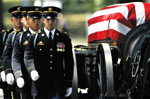 US soldiers at Dover Air Force Base in Delaware yesterday honour the return of the remains of 30 US troops killed when Taliban insurgents shot down their helicopter in Afghanistan