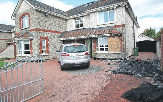 The scene at the home of Quinn chief executive Paul O'Brien in Ratoath, Co Meath, after the arson attack on Monday