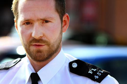 Pc Gordon Murphy, 30, and five other officers had just two shields to protect them against a mob who were trying to loot the stores, in Catford, south-east London, on Monday night. Photo: PA