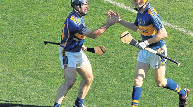 Eoin Kelly, left, and Lar Corbett celebrate after Kelly scored their side's third goal, set up by Corbett during last year's All-Ireland semi-final
