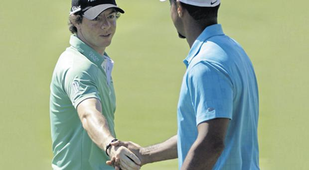 Rory McIlroy and Tiger Woods come face to face on the practice ground at the Atlanta Athletic Club yesterday