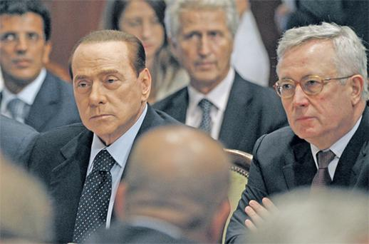 Italy's Prime Minister Silvio Berlusconi and Finance Minister Giulio Tremonti look on during a meeting with unions and employers at Chigi Palace in Rome yesterday. Italian and Spanish yields are both hovering at around 5pc – well out of the danger zone where it would be too expensive to borrow