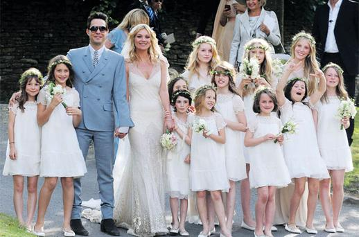 Kate Moss and Jamie Hince with their wedding party in the English village of Southrop