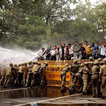 Activists from India's main opposition Bharatiya Janata Party protest against corruption in New Delhi (AP)
