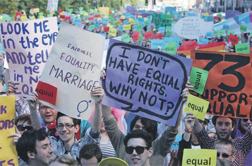 Protesters wave banners during a march for marriage equality in Dublin yesterday