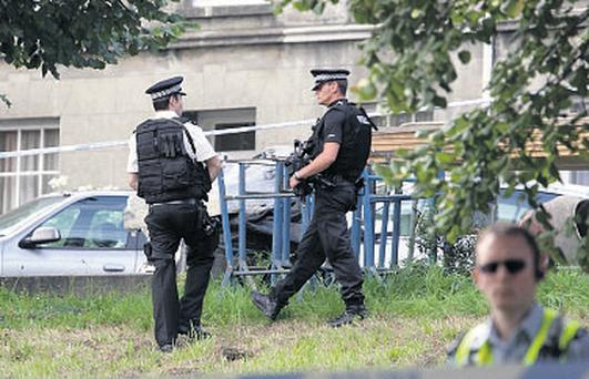 Police at the scene in St Helier, Jersey, after six people were killed in a knife attack yesterday
