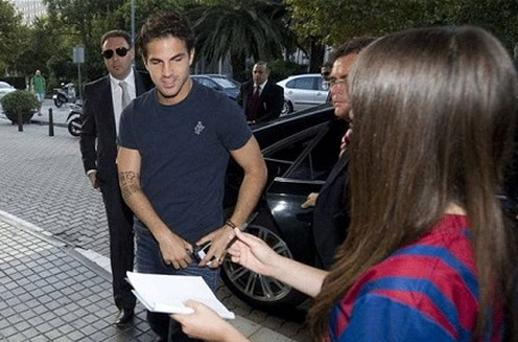 New beginnings: Cesc Fabregas arrives in Barcelona to undergo a club medical