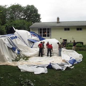 A blimp broke free of its moorings at an airport and landed in a woman's backyard (AP)