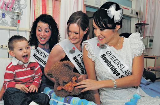Six-year-old Dylan from Enniscorthy, Co Wexford, enjoying the company of Roses Erin Loughran from New York, Tara Keigher from Edmonton, Canada and Tara Talbot from Queensland, Australia