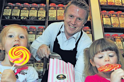 Amelie Hussey and Jane Keating with sweet shop owner Niall O'Loughlin