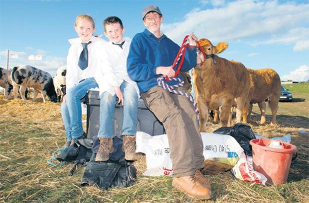 Rachel and Daniel Moloney with Joe O'Keeffe from Clare at this year's Tullamore Show and AIB National Livestock Show