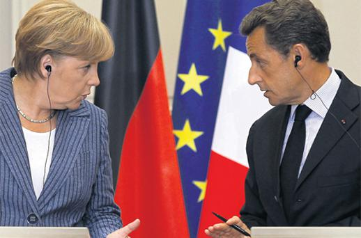 Nicolas Sarkozy and German Chancellor Angela Merkel talk during a news conference in Paris yesterday. The leaders of France and Germany met for talks to discuss further measures they can take to shore up investor confidence in the euro zone
